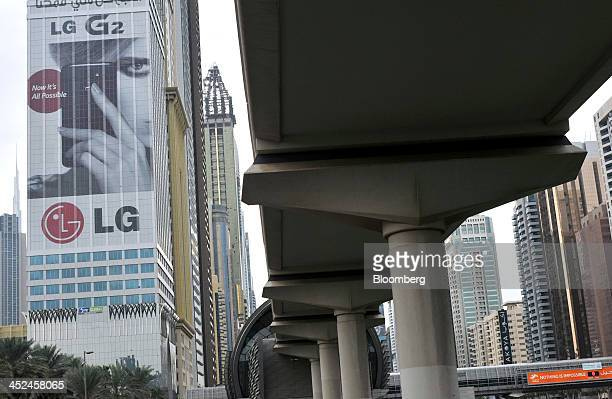 A giant advertising poster for the LG G2 smartphone produced by LG Electronics Inc adorns the side of the Al Yaqoub Tower next to the Emirates Towers...