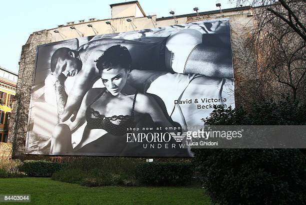 A giant advertising poster showing English footballer David Beckham and his wife Victoria posing for Emporio Armani underwears is displayed on...