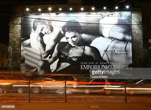 A giant advertising poster showing English footballer David Beckham and his wife Victoria posing for Emporio Armani underwear is displayed on January...