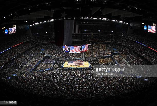 A giant American flag covers the court as the National Anthem is performed prior to the National Semifinal game of the 2011 NCAA Division I Men's...