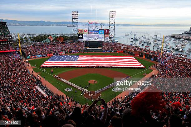 A giant American flag is displayed on the field before Game One of the 2010 MLB World Series against the San Francisco Giants at ATT Park on October...