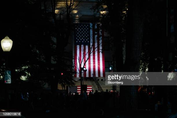 A giant American flag is illuminated before a campaign rally outside the Historic Yavapai County Courthouse in Prescott Arizona US on Monday Nov 5...