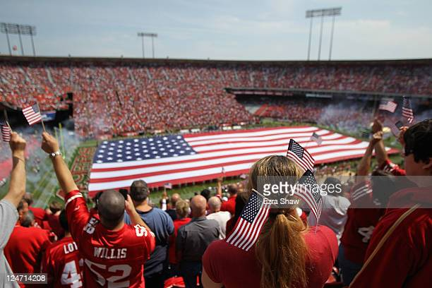 Giant American flag is spread across the field during the singing of the National Anthem before the San Francisco 49ers' season opener against the...