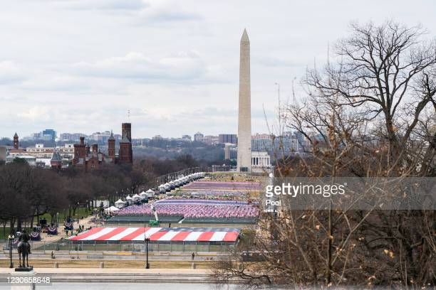 Giant American flag is unfurled on the National Mall during a dress rehearsal ahead of the 59th Inaugural Ceremonies on the West Front at the U.S....