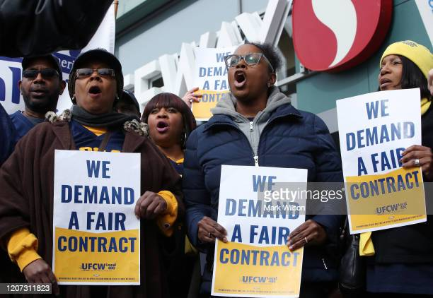Giant and Safeway grocery store workers protest in front of a Safeway Store for fair union contract negotiations on February 19, 2020 in Washington,...