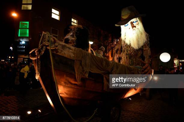 A giant animatronic puppet of an old man in a boat is seen at the start of the Land of Green Ginger Unleashed procession presented by the Hull UK...