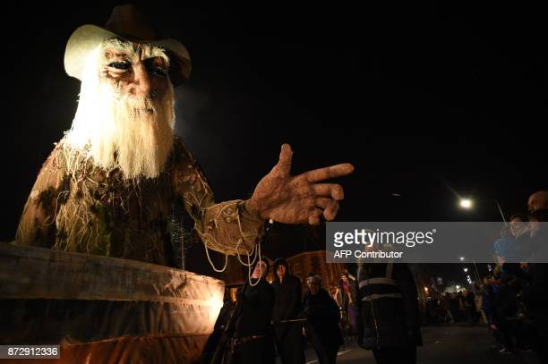 A giant animatronic puppet of an old man in a boat is seen during the Land of Green Ginger Unleashed procession presented by the Hull UK City of...
