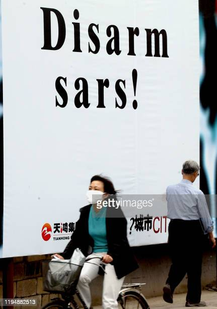 A giant antiSARS poster on display along a street aimed at catching the attention of passerbys in Beijing 15 May 2003 as the authorities step up its...