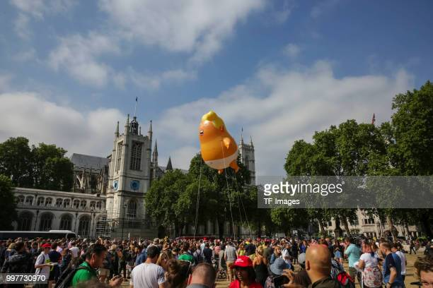 A giant baby trump balloon flies over the Parliament Square during a demonstration against the visit to the UK by US President Donald Trump on July...