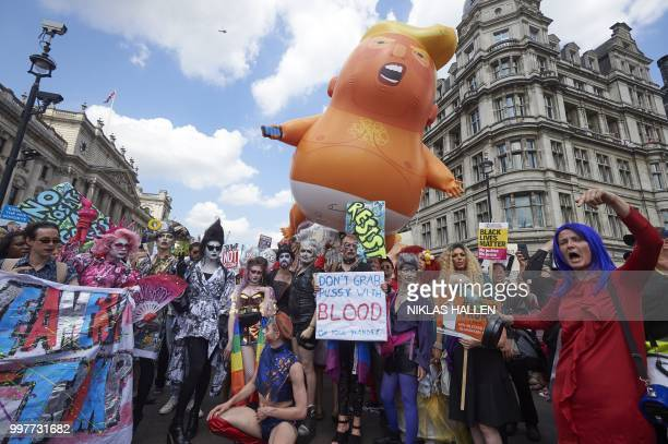 A giant balloon depicting US President Donald Trump as an orange baby joins drag queens and protesters against the UK visit of US President Donald...