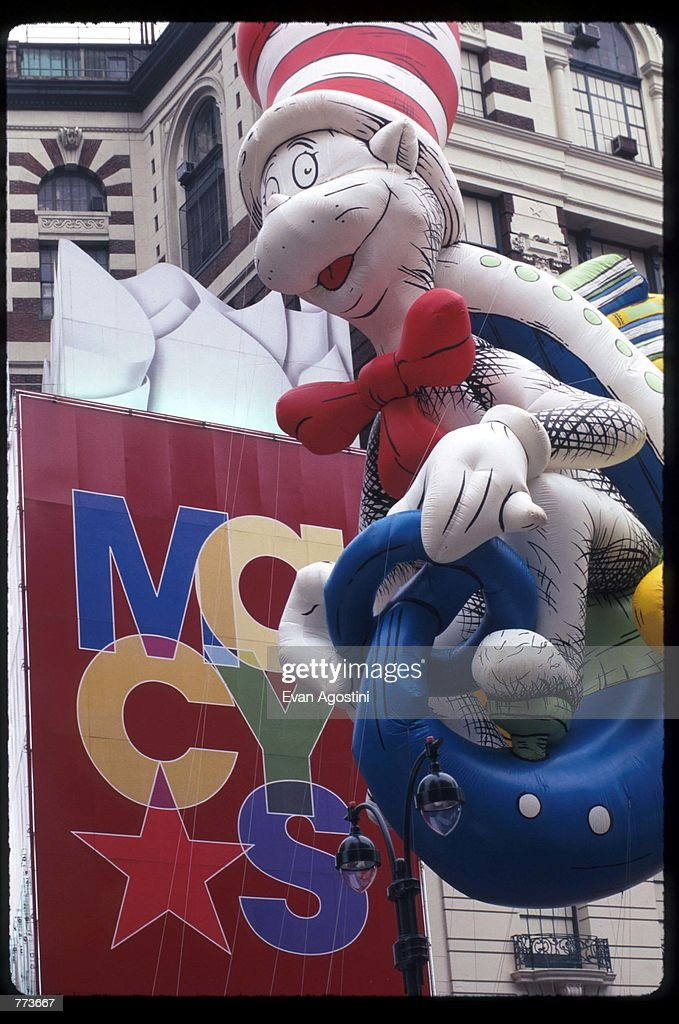 a giant balloon of dr seuss cat in the hat floats in the air at