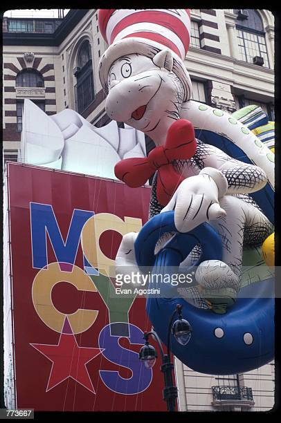 A giant balloon of Dr Seuss'' Cat In The Hat floats in the air at the 69th Macy's Thanksgiving Day Parade November 23 1995 in New York City The...