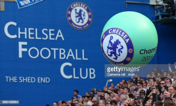 A giant balloon with the Chelsea badge on is passed amongst the fans during the Premier League match between Chelsea and Sunderland at Stamford...