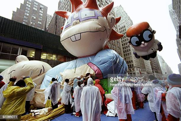 Giant balloons are deflated after the 72nd annual Macy's Thanksgiving Day Parade