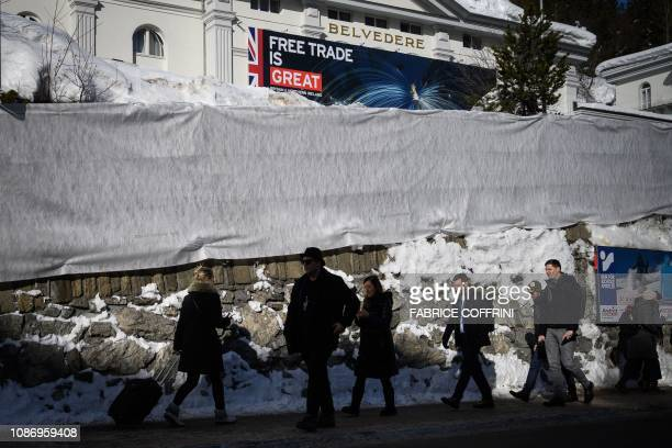 A giant banner reading Free trade is great is seen on a hotel during the World Economic Forum annual meeting on January 23 2019 in Davos eastern...