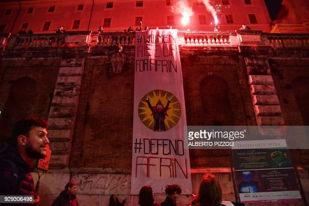 A giant banner reading 'Women Rise up for Afrin #Defend Afrin' is deployed to protest against the Turkish bombings in Afrin during a march organised...