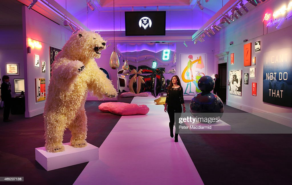 A giant bear entitled 'Life is Great' by artist Paola Pivi dominates the room of objects up for auction at Sotheby's Bear Witness collection on March 4, 2015 in London, England. The collection was acquired over decades of travel by a single collector. On show, and filling up Sotheby's in it's entirety, this eclectic exhibition displays the owners fascination with bears and skulls.