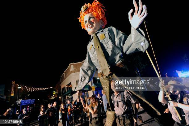 A giant Bette Midler as Winifred Sanderson puppet makes its way down Derby Street with the help of the National Parks Service during the 23rd Annual...