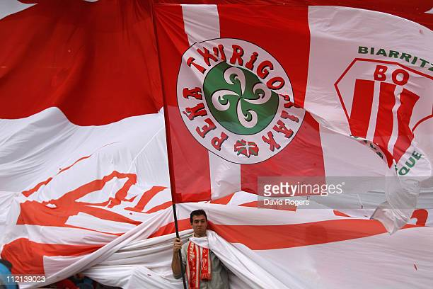 A giant Biarritz flag is unfurled during the Heineken Cup quarter final match between Biarritz Olympic and Toulouse at Estadio Anoeta on April 10...