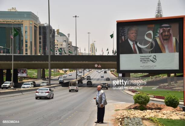 A giant billboard bearing portraits of US President Donald Trump and Saudi Arabia's King Salman is seen on a main road in Riyadh on May 19 2017 Trump...