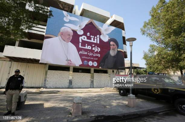 Giant billboard bears portraits of Pope Francis and Grand Ayatollah Ali Sistani in Baghdad on March 3, 2021 ahead of the first-ever papal visit to...