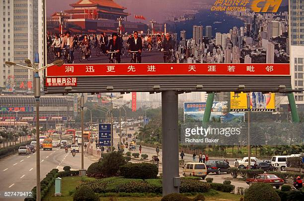 A giant billboard describes the more traditional China when the main mode of transport was the bicycle and Hong Kong was still a British colony The...