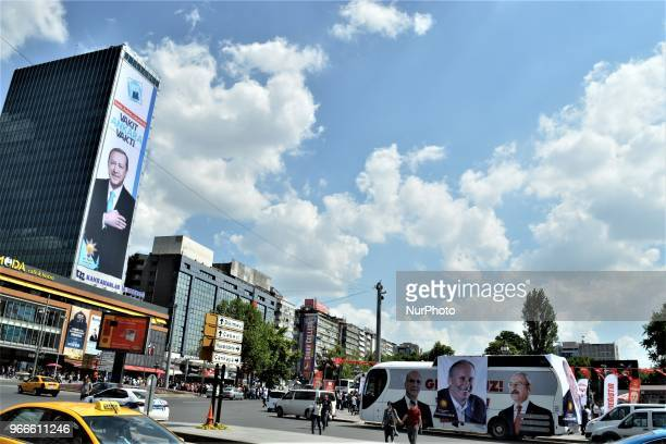 A giant billboard picturing President Recep Tayyip Erdogan posted by the ruling Justice and Development Party left and a small banner picturing...