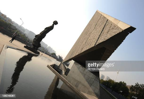 A giant bronze sculpture stands outside the Nanjing Massacre Memorial Museum on the eve of the Nanjing massacre anniversary at the Memorial Museum in...