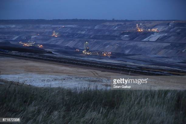 Giant bucket excavators stand in the Garzweiler openpit coal mine on November 4 2017 near Jackerath Germany The COP 23 United Nations Climate Change...