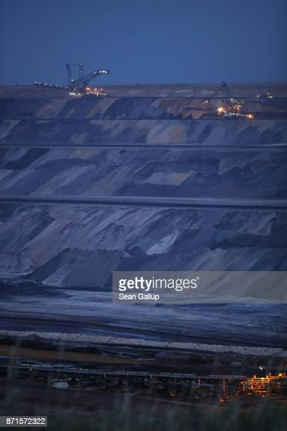 Giant bucket excavators stand on upper ledges of the Garzweiler openpit coal mine on November 4 2017 near Jackerath Germany The COP 23 United Nations...