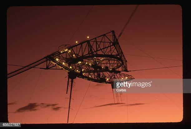 A giant cablesuspended receiver hangs above the 1000footwide Arecibo Radio Telescope on the morning of the beginning of the SETI survey