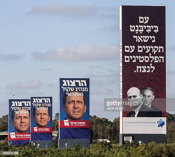 Giant campaign posters of Israeli Labour Party leader and coleader of the Zionist Union list Isaac Herzog and one poster of Israeli Prime Minister...