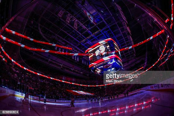 A giant Canadian flag is carried by fans during the national anthems before the Toronto Maple Leafs play the Minnesota Wild at the Air Canada Centre...
