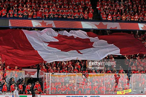 A giant Canadian flag is passed around before the game between the Calgary Flames and the Anaheim Ducks at Scotiabank Saddledome for Game Four of the...