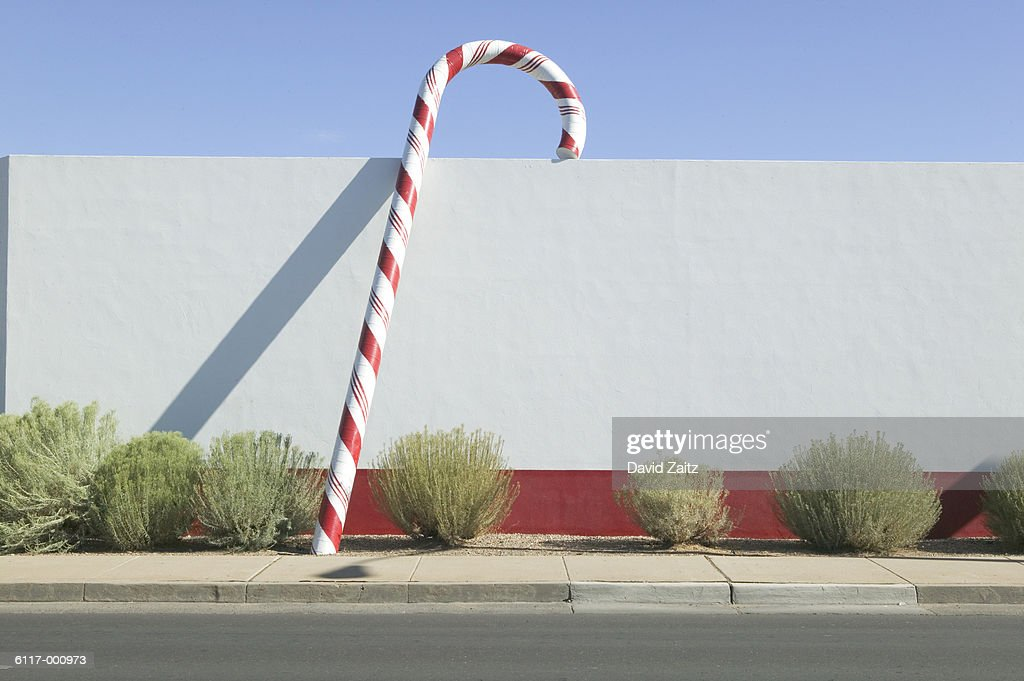 Giant Candy Cane Beside Wall Stock Photo - Getty Images