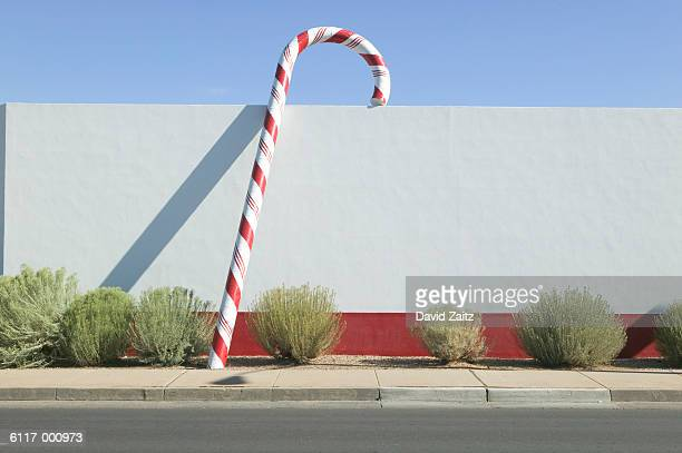 Giant Candy Cane Beside Wall