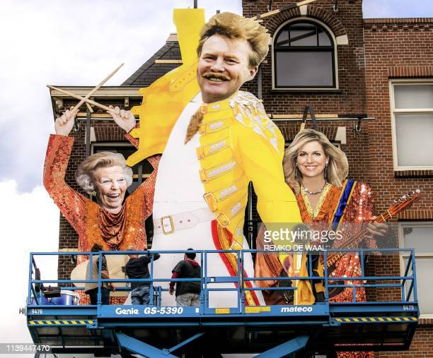 Giant carboard depicting the King Willem-Alexander of the Netherlands, Queen Maxima and Princess Beatrix is displayed on the facade of the Cafe De...