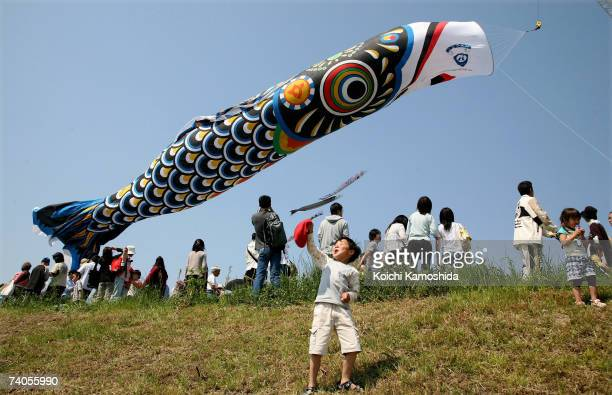 A giant carp streamer flys above the Tone River during the Citizen's Peace Festival on May 3 2007 in Saitama Japan The giant carp 100 meters in...