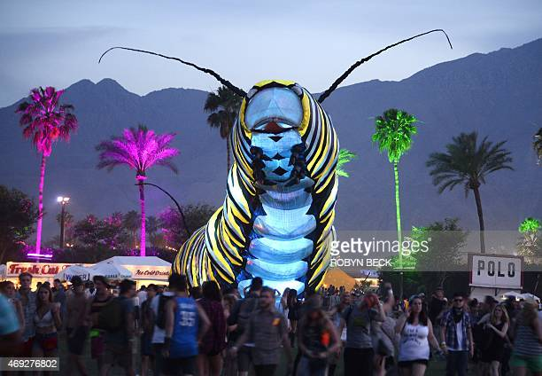 A giant caterpillar moves through the crowd on the first day of the Coachella Music Festival in Indio California on April 10 2015 AFP PHOTO / ROBYN...