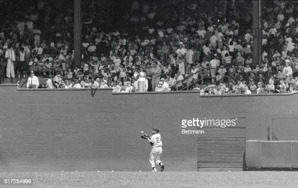 Giant center Fielder Willie Mays goes all the way to the center wall to Nab Cub first sacker Bob Speake's Fifth inning fly, in the July 15th New...