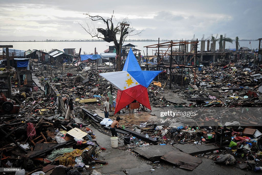A giant Christmas lantern with the colors of the Philippine flag is seen in a devastated area in Tacloban, Philippines, December 24, 2013. More than a month following Typhoon Haiyan's devastation, many survivors will be spending Christmas with no roofs over their heads and mourning missing relatives. The typhoon left more than 6,100 dead and millions displaced in its wake. Photo: Ezra Acayan/NurPhoto