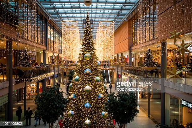 Giant Christmas tree baubles with paintings of Berlin landmarks are on display in the Potsdamer Arkaden shopping center in Berlin on December 19,...
