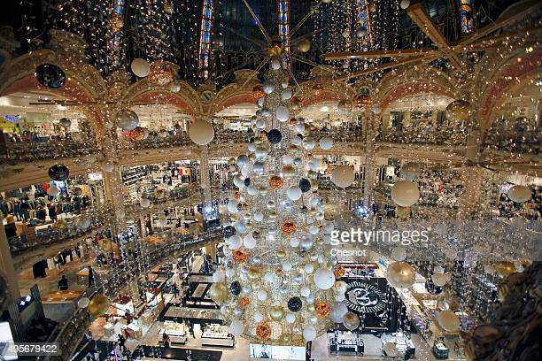 A giant Christmas tree stands in the middle of Galeries Lafayette department store during the launch of Christmas lights in Paris on November 4 2015...