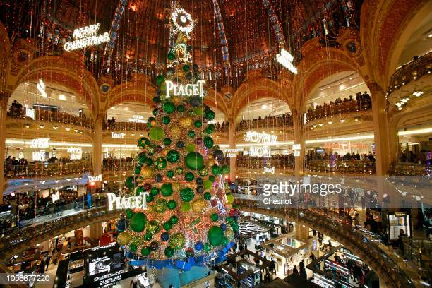 A giant Christmas tree stands under the dome of the 'Galeries Lafayette' department store after the inauguration of the store's illuminations and...
