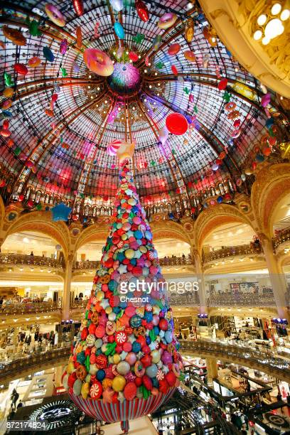 A giant Christmas tree stands under the dome of the Galeries Lafayette department store after the inauguration of the store's illuminations and...