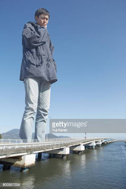 giant contemplation - giantess stock photos and pictures