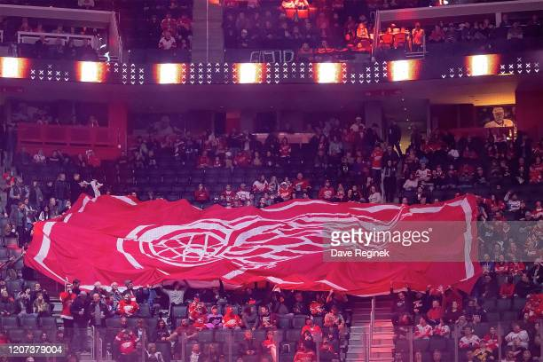 Giant Detroit Red Wings flag is passed around the rink by the fans before the start of an NHL game against the Montreal Canadiens at Little Caesars...