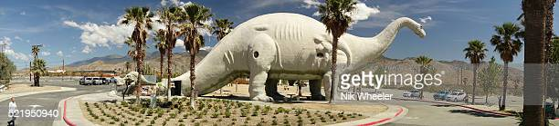 giant dinosaur building off interstate 10 at cabazon, near palm springs, california - sauropoda stock pictures, royalty-free photos & images