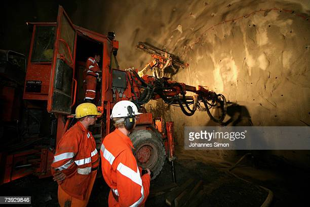 A giant drill prepares drillholes to be filled with explosives at the construction site for the Gotthard Base Tunnel on April 19 2007 near Sedrun...