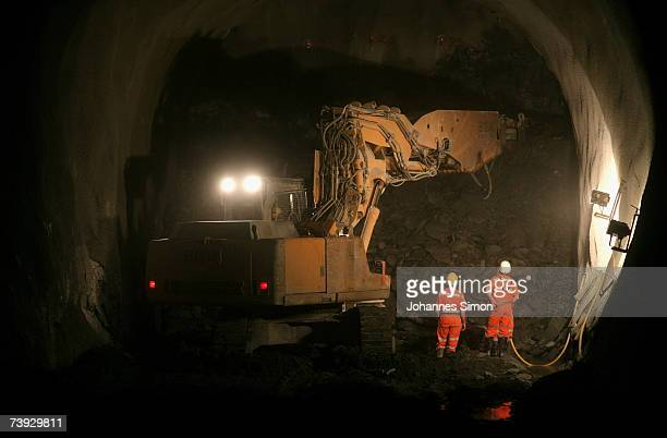 A giant drill removes Alpine rocks at the construction site for the Gotthard Base Tunnel on April 19 2007 near Sedrun Switzerland Deep beneath the...